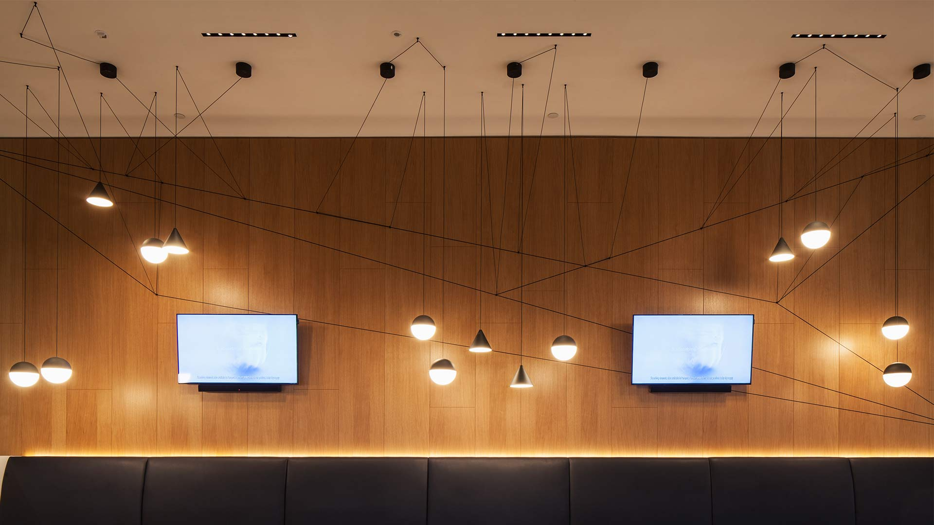 Suspended Pendants Pinned Cables Bench Seating Wood Wall Lighting Design Nulty