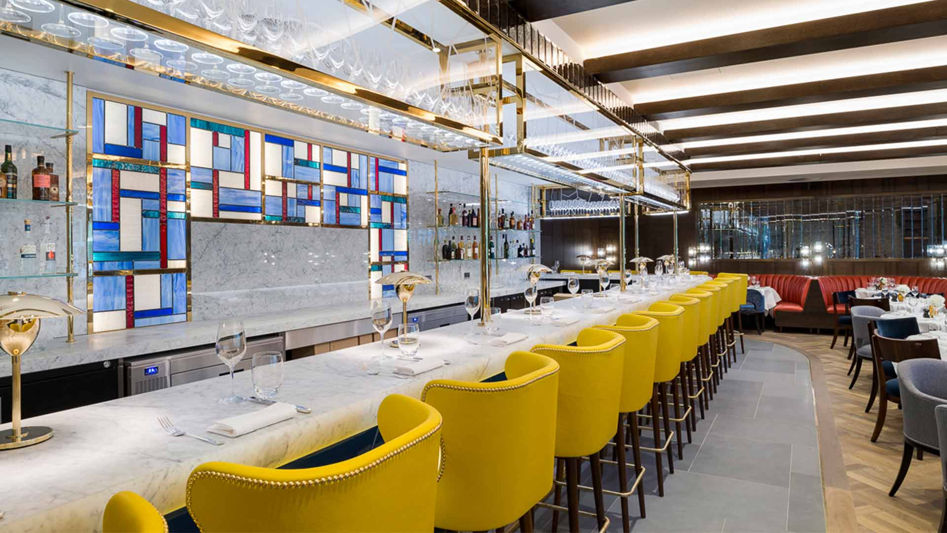 Integrated LED Lighting Glass Shelving Elegant Marble Bar Mondrain Feature Wall Yellow Stools Nulty