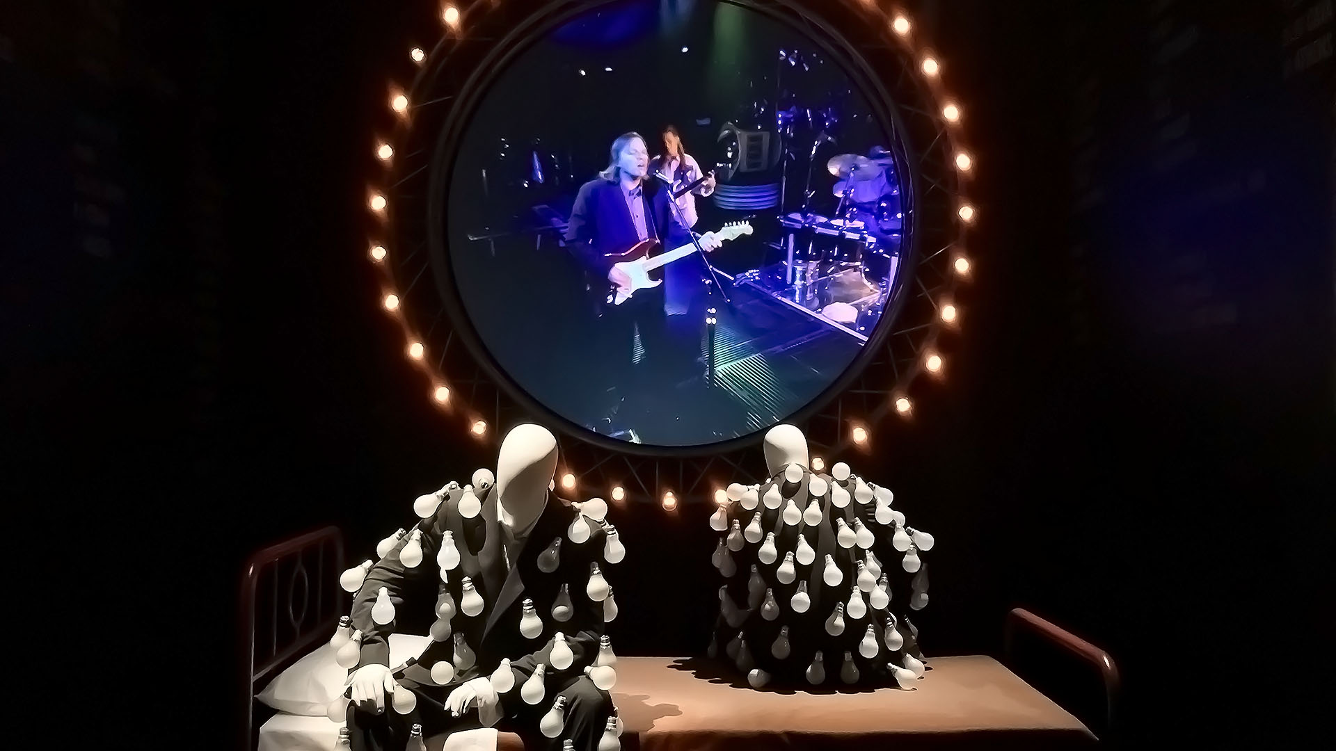 Pink Floyd Exhibition Mannequins Light Bulbs Bed Circular Image