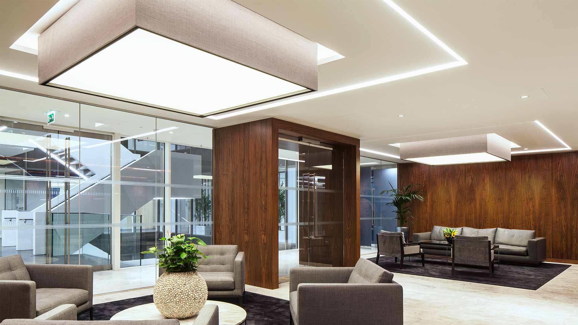Architectural Lighting Design Integrated Tiered Ceiling Large Drum Shades Office Lobby Consultants Nulty