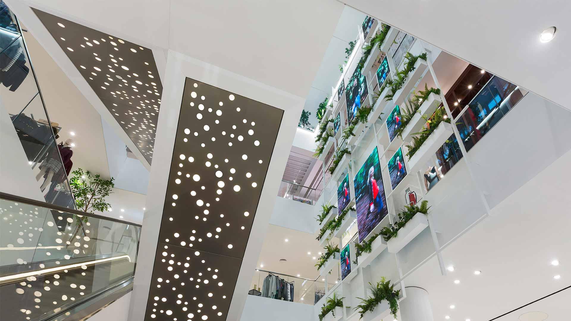 New Build Atrium Space Escalator Underside Perforated Detail Lighting Designers Nulty