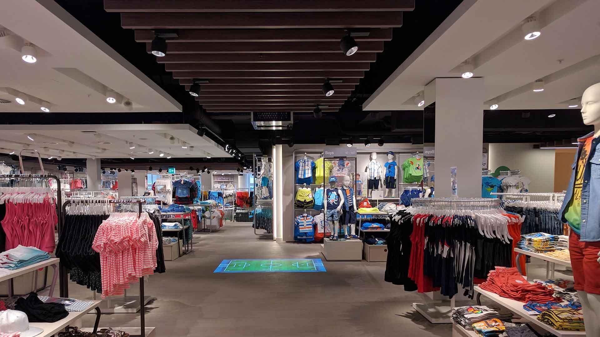 Retail Lighting Design Ceiling Strategy Wooden Slats White Raft Detail Merchandise Nulty