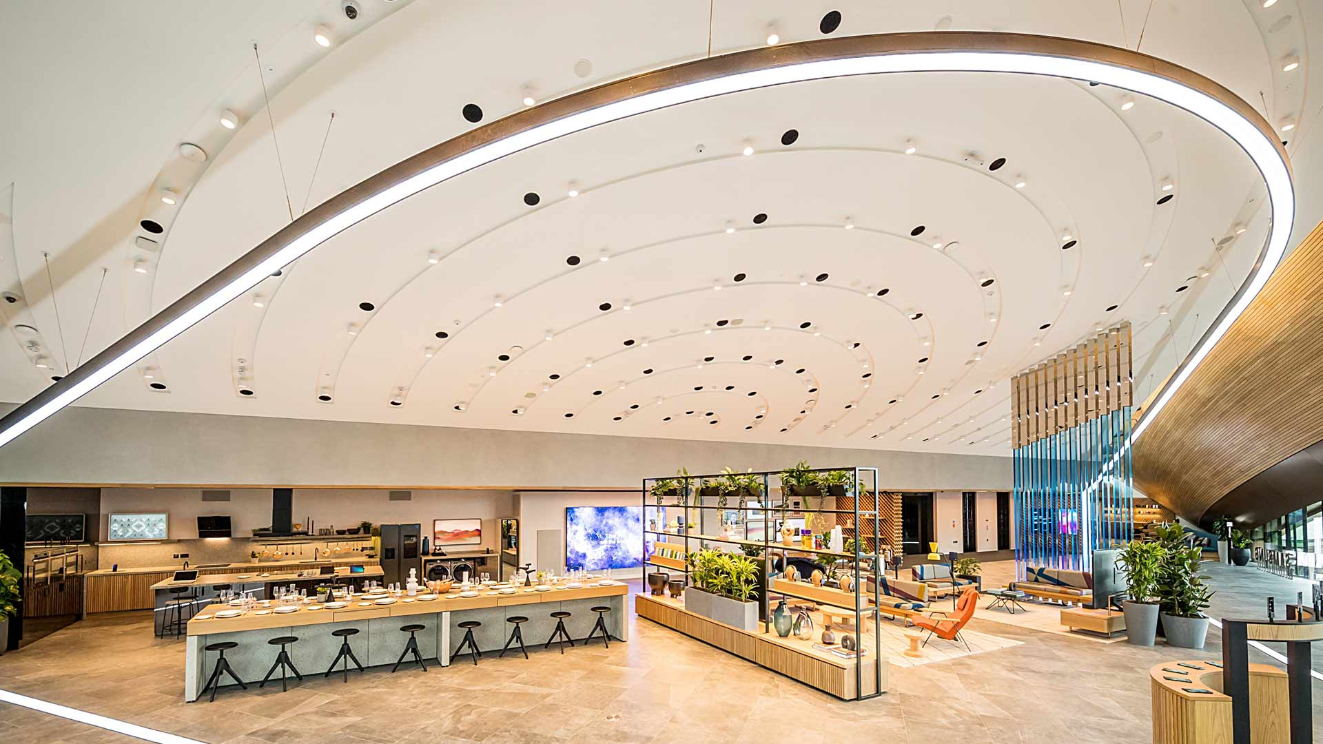 Retail Lighting Design Sweeping White Roof Swoop Light Installation Samsung KX London Consultants Nulty