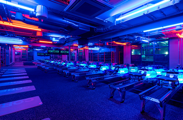 Lighting Designers Rowbots Boutique Rowing Gym Dramatic Bold Blue Amber Light Workout Studio Consultant London Nulty