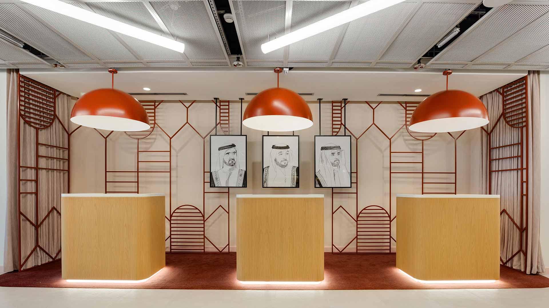 Lighting Design Hotel Reception Modern Trendy Interior Illuminated Reception Desks Oversized Orange Pendants Linear Ceiling Lights Dubai Nulty